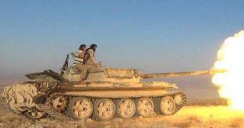 عشرات القتلى بصفوف قوات الأسد بهجوم لتنظيم الدولة بحمص وغارة صديقة توقع قتلى